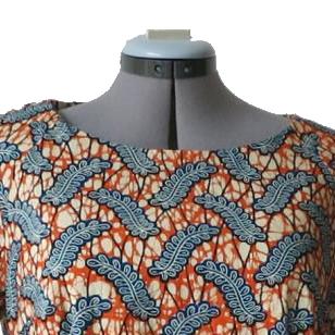 jurk oranje blauw detail hals